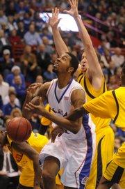 The Kent State defense strips Kansas' Markieff Morris on Monday, December 1, 2008 at Allen Fieldhouse.