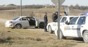 A white car sits wrecked on the side of the road Tuesday afternoon after being struck by a Lawren