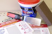 Dap DryDex Spackling goes on pink and turns white when it is ready to sand and paint.