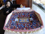 Emily Bengoa, Lawrence, sets her gingerbread Phog Allen sculpture in front of her Allen Fieldhouse creation for the 2008 Eldridge Hotel Gingerbread Festival and Auction.