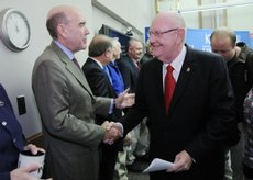 Provost and Executive Vice Chancellor Richard Lariviere, left, greets Chancellor Robert Hemenway, as Hemenway leaves a press conference Monday, where he announced that he will step down from his post effective June 30, 2009.