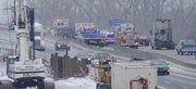 Slick conditions may have contributed to this two-vehicle accident in the eastbound lane of I-70 just west of the Kansas River bridge Tuesday.  Emergency personnel work the scene about 1:30 p.m. The photo is from the Michigan Street bridge over I-70, looking to the east.
