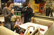Kendra Kuhlman, along with her husband, Quinn, often take their children Les, 6 months old, and Keirn 20 months old, out to eat. Kendra has leaned to pack a few extra items to keep her children entertained.