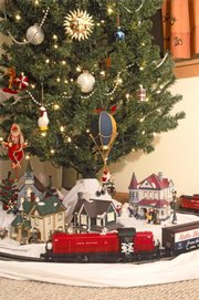 model railroader magazine shows a model train under a christmas tree memories are what often - Train For Around Christmas Tree