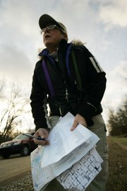 Nancy Leo, of Prairie Village, checks off various species of birds as other birders call out their names during the count Sunday morning at Perry State Park.
