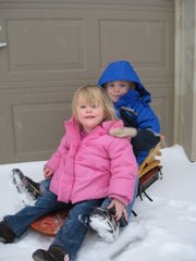 Clay and Sydney sledding in Tuesday's snowfall. Amy Higbie submitted the photo.
