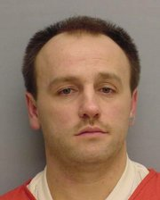 David Hause Jr. was caught in Kansas City, Kan., on Tuesday and is charged with robbing Midwest Regional Credit Union on Friday.