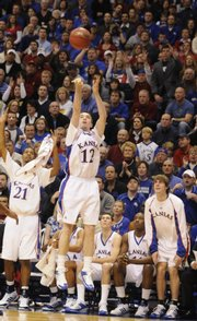 Kansas guard Brady Morningstar hoists up a three-pointer during the second half Saturday at Allen Fieldhouse.