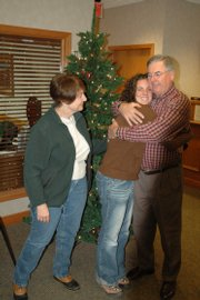 "It&squot;s been a happy reunion for the Skaggs family this Christmas. Anna, hugging her dad, Ron, has just returned after 17 months in Africa in the Peace Corps. Her mom, Merrie, left, got the same treatment. It has them singing ""I&squot;ll Be Home For Christmas."""