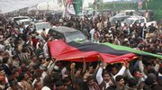 Supporters of Pakistan's slain former Prime Minister Benazir Bhutto chant slogans as they arrive at her mausoleum to pay homage, Saturday, Dec. 27, 2008 in Garhi Khuda Bakhsh near Larkana, Pakistan. Up to 200,000 Pakistanis gathered at the mausoleum of Bhutto on the first anniversary of her assassination, some of them walking hundreds of miles (kilometers) to get there.