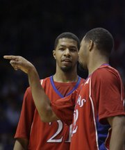 The Morris twins Markieff (left) and Marcus talk during a break in the action against Albany on Tuesday, Dec. 30, 2008 at Allen Fieldhouse.