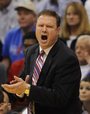 Kansas University basketball coach Bill Self applauds his team against Temple on Dec. 20 in Allen Fieldhouse. The Jayhawks play host to Albany at 8 tonight.