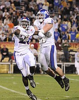 Kansas defenders Phillip Strozier, left, and Joe Mortensen celebrate a defensive stop against Minnesota near the goal line during the third quarter of the Insight Bowl Wednesday, Dec. 31, 2008 at Sun Devil Stadium in Tempe, Arizona.