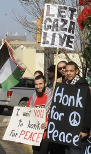 Diaa Elashkar, left, Overland Park, and Abdul Majeed, Kansas City, Kan., were among 50 people who turned out with Voices for Palestine, a Kansas University student organization, and Lawrence's Coalition for Peace and Justice at the Douglas County Courthouse on Saturday. They demonstrated against Israel's bombardment of the Gaza Strip.