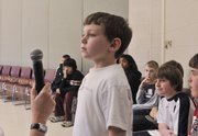 Sunflower Elementary School student John Ely awaits his turn during a spelling bee Jan. 9 at the school.