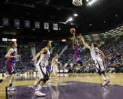 Kansas guard LaChelda Jacobs (00) hangs for a shot attempt over Kansas State's Shalee Lehning (5) during the second half of Saturday's game in Manhattan, Kan.