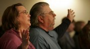 Becky Dunavin, left, and her husband, Rod, sing a hymn with other congregants of the Williamstown Assembly of God during a prayer vigil Sunday night for Shawn Fowler. Fowler, 44, has been missing since Dec. 10, 2008.