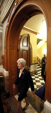 Kansas Gov. Kathleen Sebelius enters the House chamber as she prepares to deliver her State of the State address Monday.