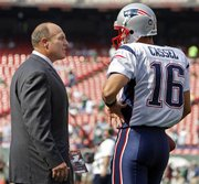 Scott Pioli, left, New England Patriots vice president of player personnel, chats with Patriots quarterback Matt Cassel, right, before an NFL football game in East Rutherford, N.J., on Sept. 14, 2008. Pioli, who helped build and lead a dynasty in New England, is now in charge of the Kansas City Chiefs as general manager of the NFL football team.