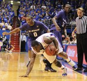 Kansas guard Sherron Collins regains his footing as he spins around Kansas State guard Jacob Pullen, left, and Jamar Samuels during the second half Tuesday, Jan. 13, 2009 at Allen Fieldhouse. Collins and center Cole Aldrich combined for 11 points when the Jayhawks raced to an early 18-0 lead the last time KU and K-State met.