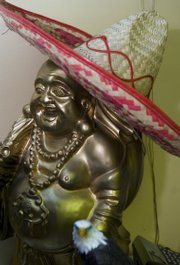 A buddha wearing a sombrero sits behind the cash register at Jasmin restaurant, 719 Main St., Eudora.