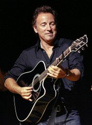 In this Nov. 5, 2008 file photo, Bruce Springsteen plays his guitar up for auction at the 2nd annual Stand Up For Heroes: A Benefit for the Bob Woodruff Foundation in New York.