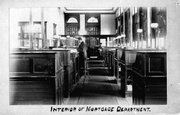 This is an image of the interior of J.B. Watkins' mortgage department. The building was later given to the city of Lawrence in 1929.