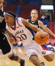 KU's Sade Morris drives to the hoop against Missouri on Wednesday. She was 6-for-8 in the first half.