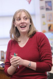 Tracy Murray, social studies teacher at Lawrence High School, was surprised in class Wednesday with a Wal-Mart Teacher of the Year Award. Wal-Mart will donate $1,000 to the school, and Murray also will receive a $100 gift card. Murray said she would spend the gift card on items to help students in her classroom.