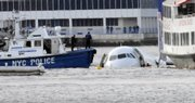 An Airbus 320 US Airways aircraft that has gone down in the Hudson River is seen in New York, Thursday Jan. 15, 2009. A US Airways jetliner crashed into the frigid Hudson River on Thursday afternoon after a collision with a flock of birds disabled both its engines, sending more than 150 passengers and crew members scrambling onto rescue boats, authorities say. No deaths or serious injuries were immediately reported.