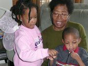 Justner Graham cuddles with her grandchildren Kyndall, 5, and Paul Jr., 3, in Ypsilanti, Mich.