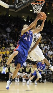 Kansas center Cole Aldrich swings around for a reverse layup against Colorado forward Jermyl Jackson-Wilson during the first half Saturday, Jan. 17, 2009 at the Coors Events Center in Boulder, Colorado.