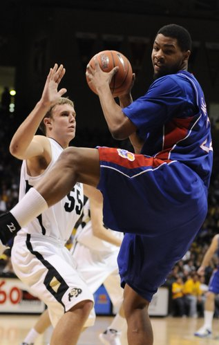 Kansas forward Marcus Morris spins away from Colorado forward Trey Eckloff with an offensive rebound during the second half Saturday, Jan. 17, 2009 at the Coors Events Center in Boulder, Colorado.