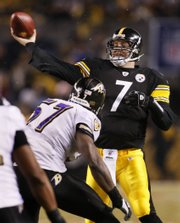Pittsburgh Steelers quarterback Ben Roethlisberger throws a pass over Baltimore Ravens' Bart Scott (57) during the first quarter of the NFL AFC championship football game in Pittsburgh, Sunday, Jan. 18, 2009.