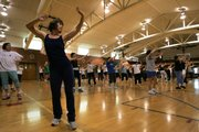 "Staci Smidt participates in a Zumba class in 2009 at the Community Building. ""It's a blast,"" said Smidt, who also said this was her first Zumba class. ""I don't like to think I'm working out, and this kind of fools me."""