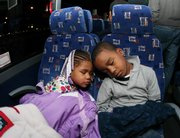 Najai Johnson,4, left,  and her brother Dionta Johnson Jr., 4, sleep on a bus as they travel from Washington to Atlanta on a charter bus, Saturday, Jan. 17, 2009