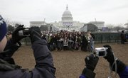 A group of students from Bellarmine Jefferson High School from Burbank, Calif., pose for pictures in front of the Capitol in Washington, Monday, Jan. 19, 2009,  where the swearing in for President-elect Barack Obama will take place on Tuesday.
