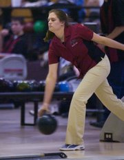 Junior Danielle Husted bowled a personal best Thursday with a 246. Lawrence High School bowling team hosted a varsity tri meet at Roayl Crest Lanes Thursday with Oskaloosa and Leavenworth.