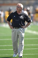Bill Miller roams the field in this photo from his days as an assistant coach at Western Michigan.
