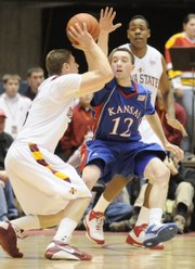 Kansas guard Brady Morningstar defends against a shot by Iowa State guard Lucca Staiger during the first half, Saturday, Jan. 24, 2009 at Hilton Coliseum in Ames, Iowa.