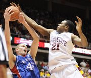 Iowa State's Craig Brackins (21) fights for a rebound with Kansas University's Cole Aldrich in this Jan. 24, 2009, file photo in Ames, Iowa.