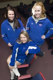 Seniors Elle Pottorf (from left), Dougie McCaulley and Valerie George were some of the KU softball team that met with the media Monday, Jan. 26.