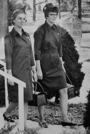 Mrs. Robert Palmer, left, and Mrs. George Lauppe, show the new uniforms adopted by the Douglas County Visiting Nurses Association, Inc. in this Journal-World file photo. They were the first nurses to work for the nonprofit agency that officially opened Feb. 2, 1969.