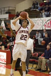 Lawrence High's Dorian Green (22) lines up a potential game-winning three-pointer with Lawrence High down by one point during the final minute of the game Thursday, Jan. 29, 2009, against Hogan Prep at LHS. Green buried the shot, putting the Lions up by two.