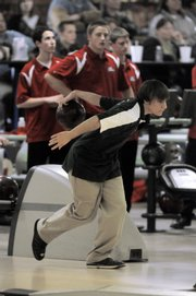 Free State Junior Rob Wagner sets his sights on the pins. Wagner won the individual crown with a 660 three-game series, but the Firebirds fell to Olathe North, 2,554-2,524, on Thursday at Royal Crest Lanes.