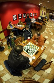 Lawrence includes a mix of national and local retailers. Maksin Smith, 6, and his brother Dmitri Smith, 10, watch James Fouche-Schack play chess at Borders, 700 N.H.