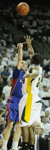 Kansas guard Brady Morningstar puts up a three over Baylor guard LaceDarius Dunn during the first half Monday, Feb. 2, 2009 at the Ferrell Center in Waco.