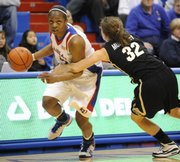KU's Danielle McCray tries to make a move on Colorado's Kelly Jo Mullaney during the Jayhawks' matchup with CU on Feb. 4, 2009.