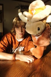 Jacob Caldwell always keeps a stuffed Texas Longhorn beside him as he watches the Longhorns play on TV. The Southwest Junior High School eighth-grader tells Angle member Gavin Kirk he's very superstitious when it comes to sports.