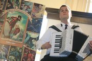 "Author Daniel Handler plays the accordion as he meets with his readers during a 2006 book signing in New York City. Handler is preparing for a March release of ""The Composer Is Dead,"" a CD-and-book symphony aimed at teaching children about musical instruments."